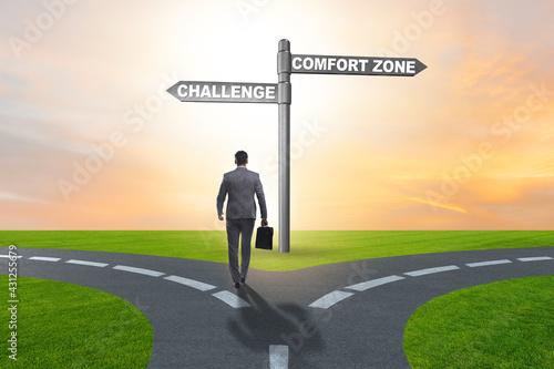 Fotografija Businessman choosing between leaving comfort zone or not