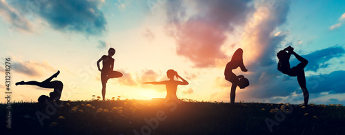 Woman in yoga poses meditation at sunset.
