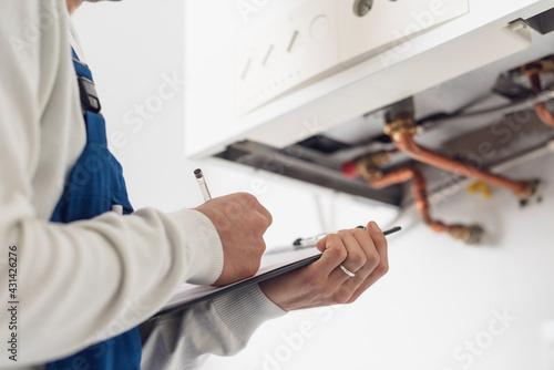 Obraz na plátne Professional plumber doing a boiler check
