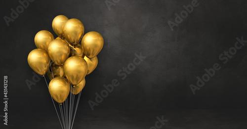 Valokuvatapetti Gold balloons bunch on a black wall background