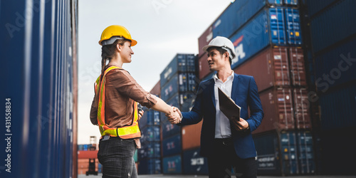 Fotografie, Obraz worker teamwork and partner of foreman, engineer, and businessman working in an international shipping area, concept of business industrial and working in container yard