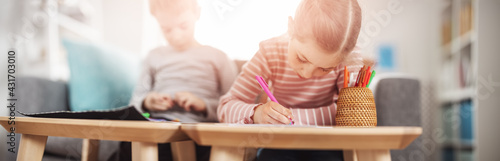 Children playing together with modeling clay and drawing by pencils Fotobehang
