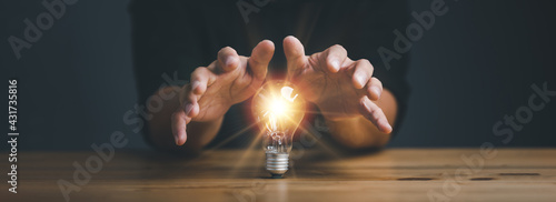 businessman protect light bulb, Creative new idea. Innovation, brainstorming, inspiration and solution concepts.