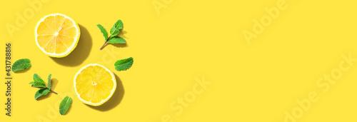 Fotografie, Obraz Fresh yellow lemons with mints overhead view