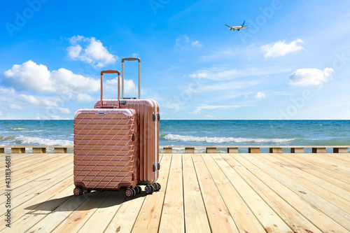 Wallpaper Mural Travel suitcase on wood floor by the sea,travel concept.