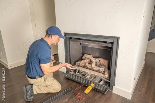 Stampa su Tela Technician working on a gas fireplace