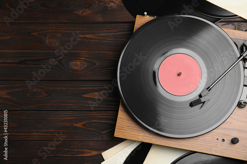 Fotografie, Tablou Modern player and vinyl records on wooden background, flat lay
