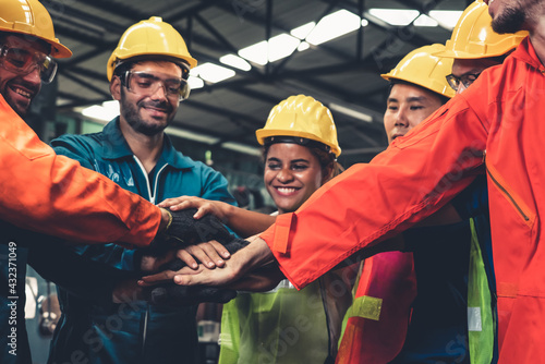 Fototapeta Skillful worker stand together showing teamwork in the factory