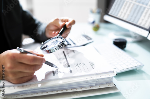 Valokuvatapetti Audit And Fraud Investigation. Auditor Using Magnifying Glass
