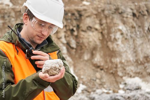 Fototapeta geologist examines a mineral sample