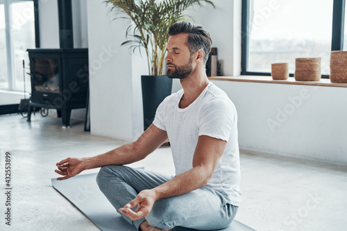 Concentrated young man doing yoga