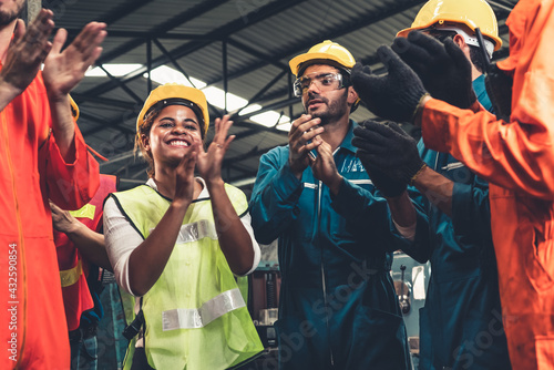 Skillful worker celebrate success in the factory . Industrial people and manufacturing labor concept .