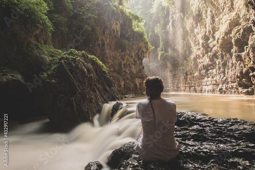 Fototapeta Young Woman in the Green Canyon ( Cukang Taneuh ) Cijulang Pangandaran