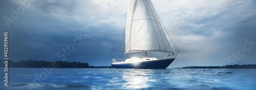 Obraz na płótnie Blue sloop rigged yacht sailing in an open Baltic sea, close-up