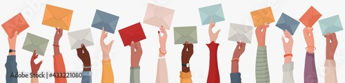 Fotografia Group of multi-ethnic business people with raised arms holding an envelope