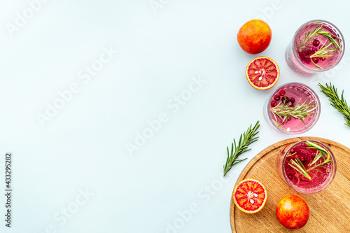 Citrus sangria or lemonade with blood red oranges and ice Fototapeta