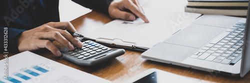 Accountant or banker making calculations Bookkeeper Clerk, Bank Advisor And Auditor Fototapet