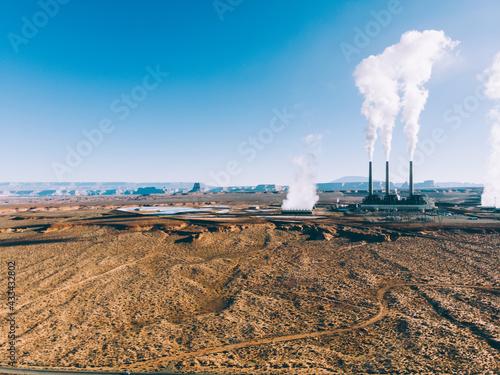 Large ground terrain with big polluting factory Fototapeta