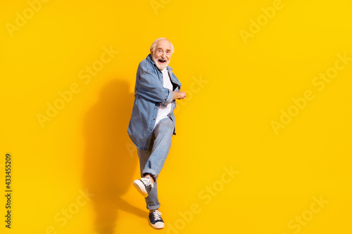 Fotografiet Full body photo of funky happy cheerful old man dance feel young good mood isola