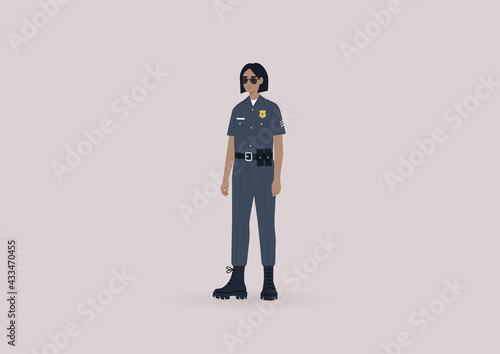 Foto A young female police officer on duty wearing a uniform and sunglasses