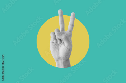 Fotografía Digital collage modern art. Hand showing peace hand sign