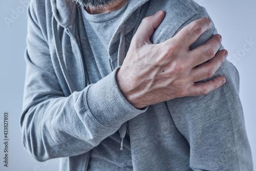 Obraz na plátne Shoulder joint pain, man with severe ache as symptom of osteoarthritis