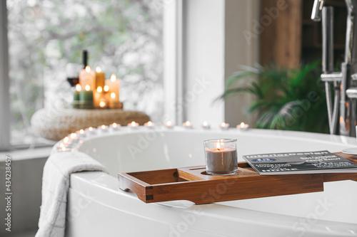 Canvastavla Stylish interior of modern bathroom with burning candles, closeup