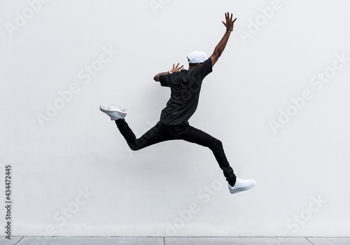 Fotografie, Obraz African man jumping in to the air