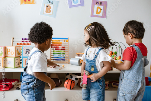 Fényképezés Young children playing with educational toys