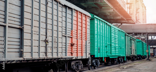 Photo Freight railroad cars stand at dead end station, glare of sun
