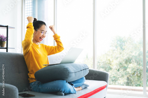 Excited female feeling euphoric celebrating online win success achievement result, young asian woman happy about good email news, motivated by great offer or new opportunity