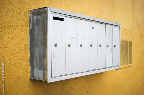 Old mailboxes on yellow building #434669041