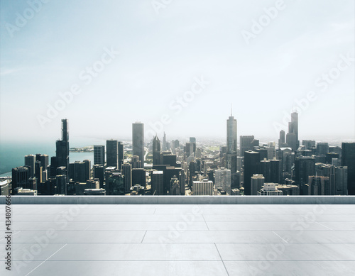 Fototapeta Empty concrete rooftop on the background of a beautiful Chicago city skyline at