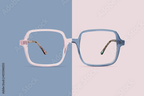 Pink and blue color glasses isolated on background, ideal photo template for display or advertising sign or for a web banner
