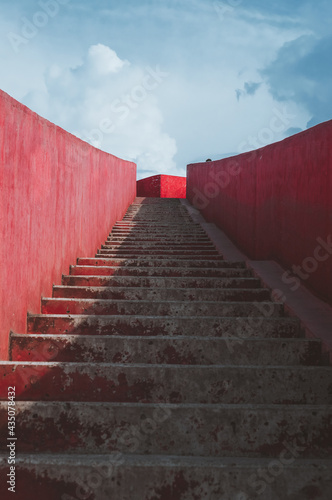 Fotografie, Obraz Red Stairs to the Blue Sky with Clouds