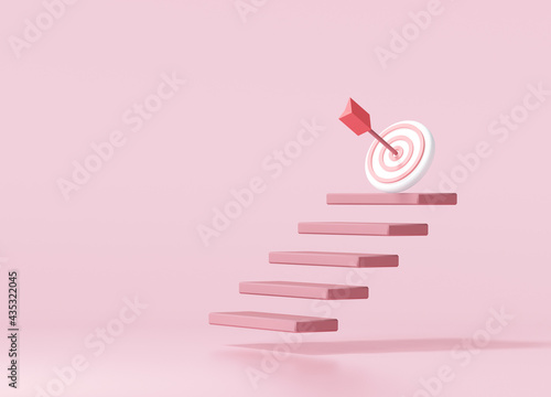 Fotografia Red arrow hit the center of target on top of the staircase