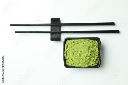 Obraz na plátně Chopsticks and wasabi sauce on white background