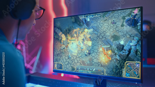 Fotografering Professional eSports Gamer Plays RPG MOBA Mock-up Video Game with Super Action and Fun Special Effects on His Personal Computer, Talks to Teammates using Headset