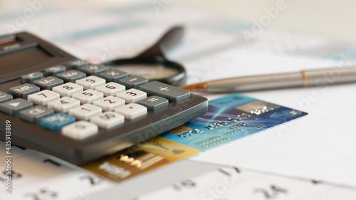 Billede på lærred debt free from credit card concept background with calculator and magnifier on d