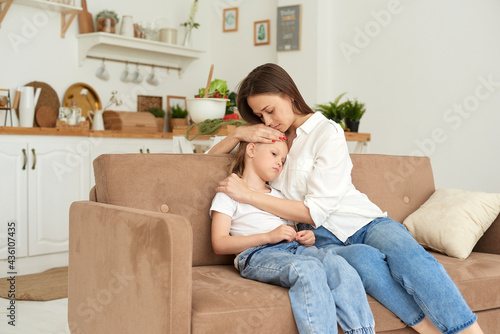 Photo A young mother supports her daughter, calms her down and strokes her head