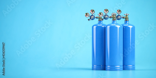 Stampa su Tela Blue oxygen tanks or cylinders on blue background.