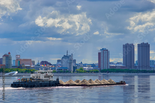 Wallpaper Mural A barge loaded with building materials moves along the Amur River
