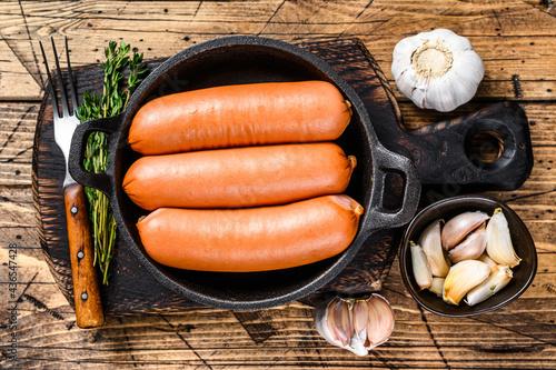Fotografie, Obraz Sausages bratwurst from pork meat in a pan