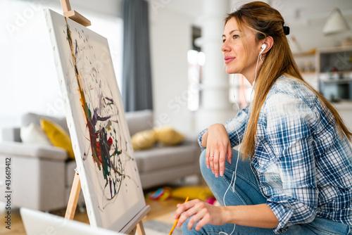 Vászonkép Creative beautiful woman painting at home