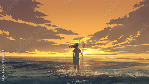 Fotografia woman standing on the sea with IV pole with blood bag and looking the sunset sky