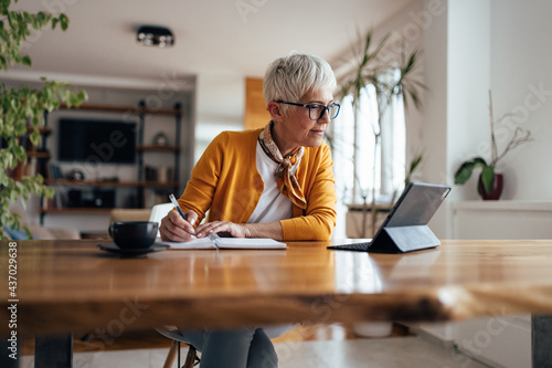 Fotografie, Obraz Senior businesswoman, working hard, from home office.