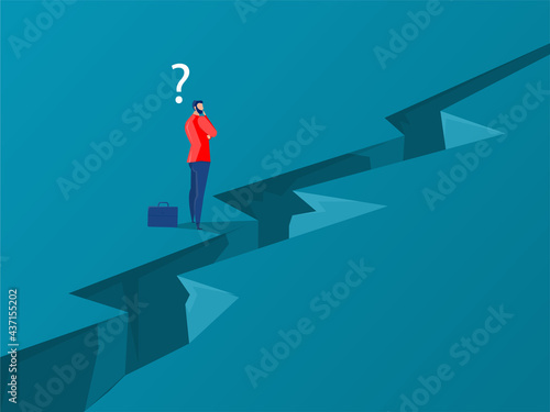 Fotografiet Businessman standing with thinking overcomes obstacle chasm on way to success