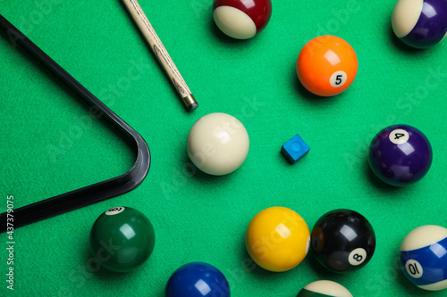 Flat lay composition with balls and cue on billiard table Fototapeta