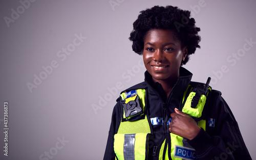 Wallpaper Mural Studio Portrait Of Smiling Young Female Police Officer Against Plain Background