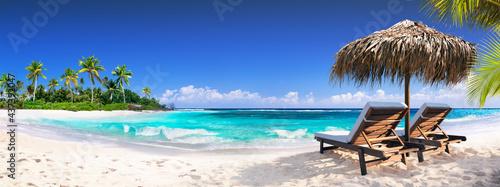 Obraz na płótnie Chairs In Tropical Beach With Palm Trees On Coral Island